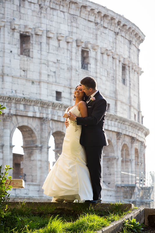 Bride and groom at the Roman Colosseum during their wedding photos