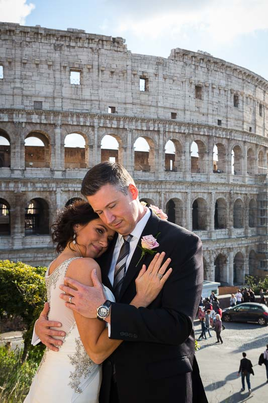 Portrait picture of a just married couple by the coliseum