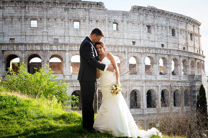 Newlyweds getting their picture taken at the Coliseum in Rome