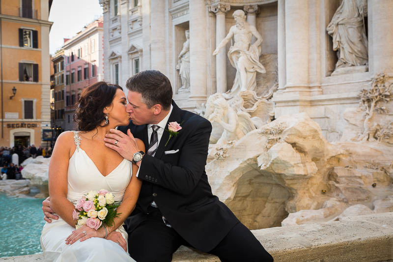 Kissing at the Trevi fountain in Rome during a wedding