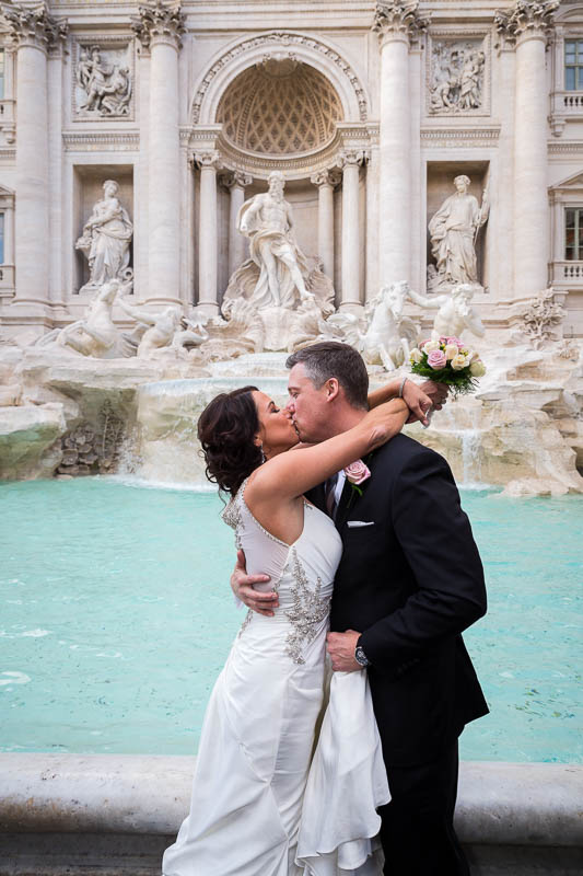 Married and in love at Fontana di Trevi in Rome