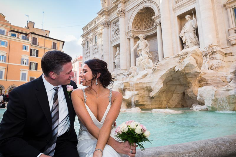 Newlyweds kissing at the Trevi fountain