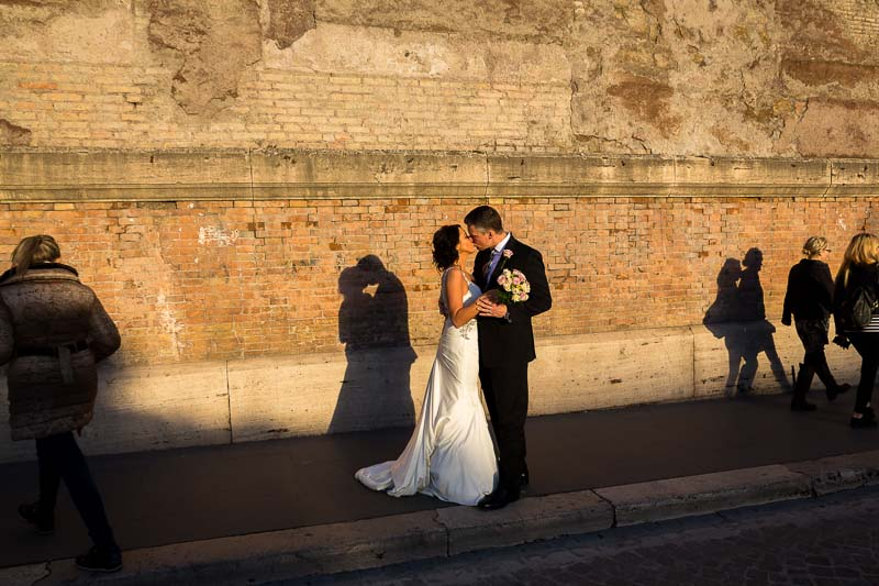 Wedding couple kissing on the streets of Rome