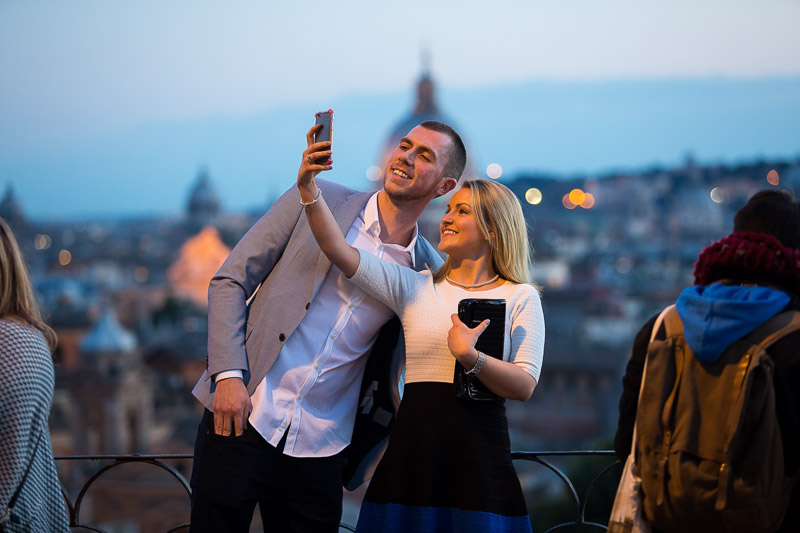 Couple taking a selfie in a scenic roman place