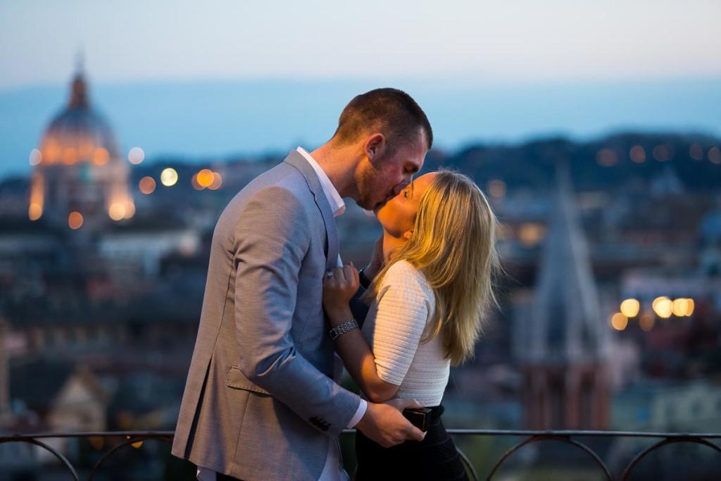 Romantic kiss at night in the roman streets