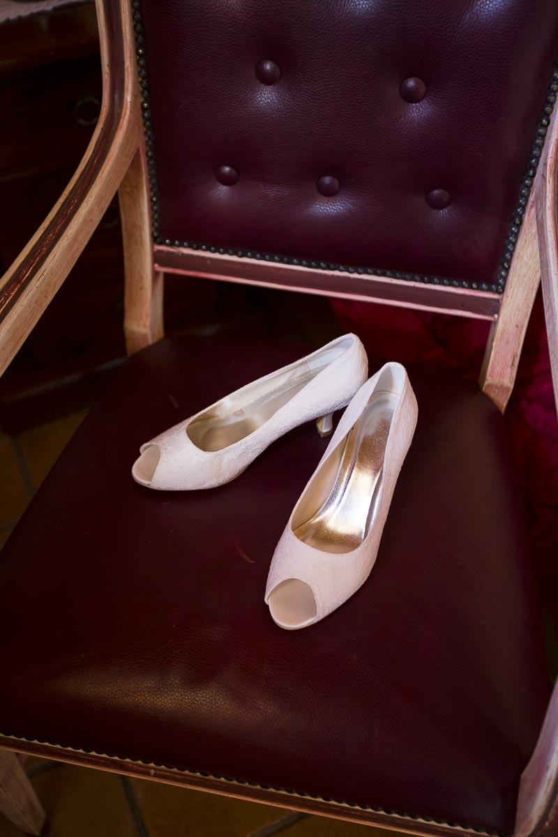 Bridal shoes photographed on a chair