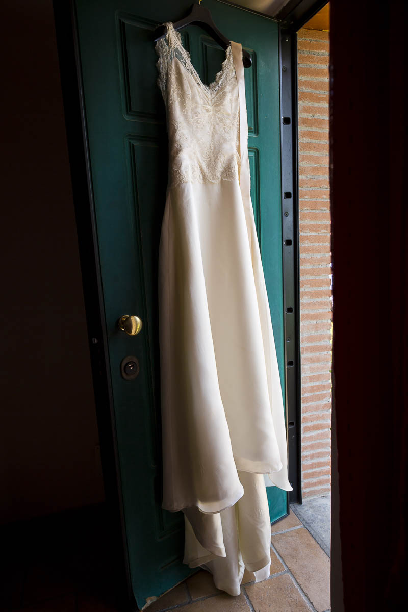 Marriage dress hanging from a door