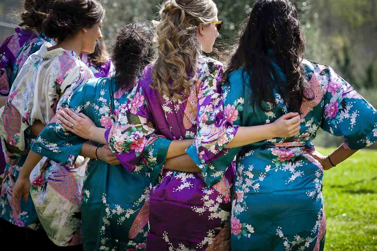 Bridesmaids wearing robes photo from behind