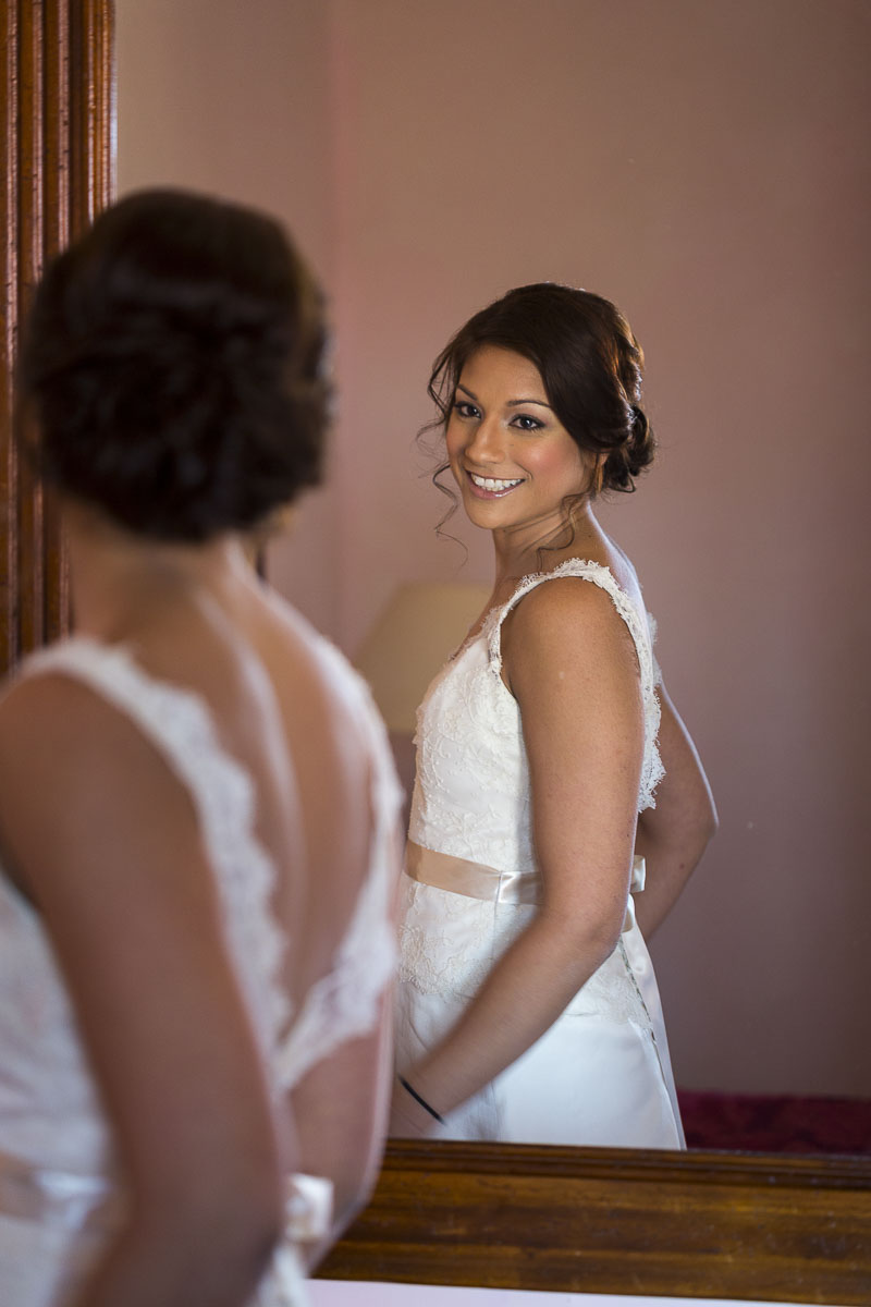 The bride looking in the mirror when ready