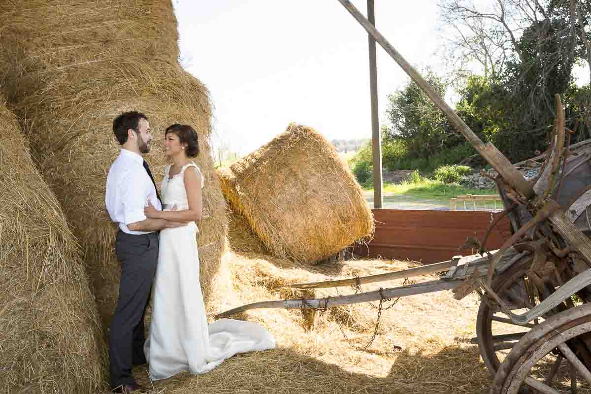 Photography session by a barn with hay