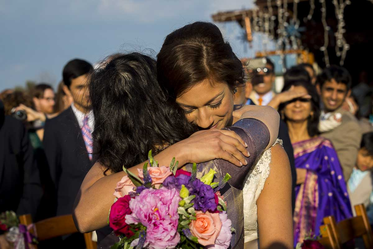 Bride hugging mom before the marriage ceremony