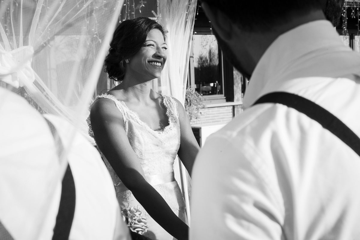 B&w image of a woman getting married