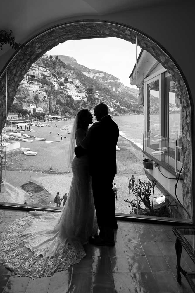 Honeymoon silhouette overlooking the Italian beach riviera