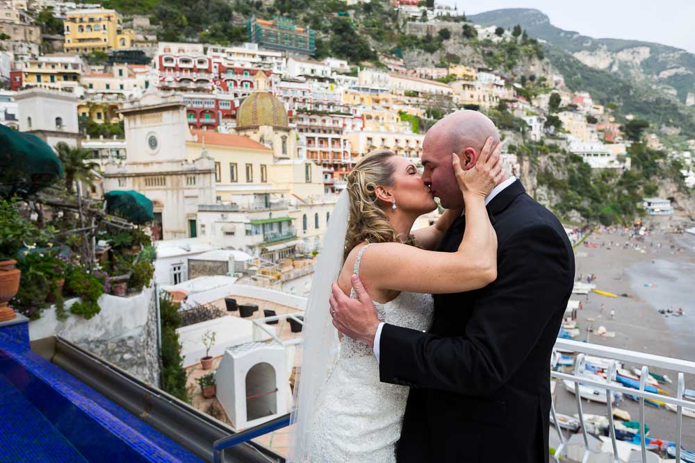Wedding couple kissing in Positano Italy