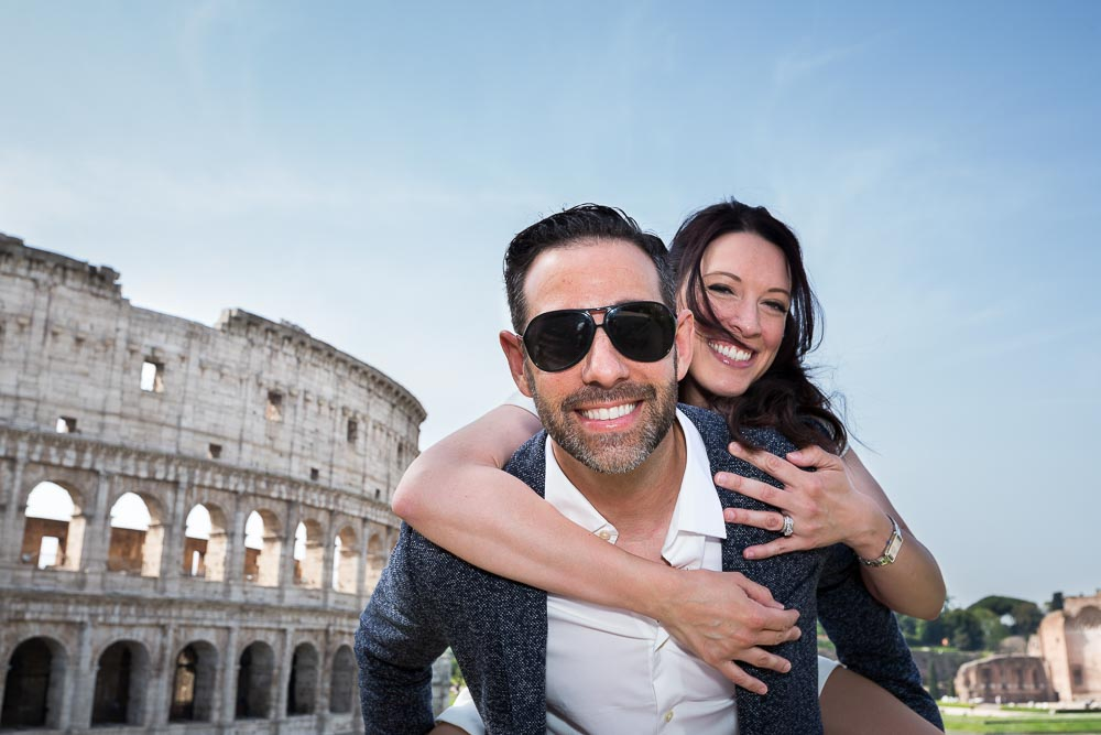 Couple fun and lively portrait in Rome Italy at the Roman Colosseum