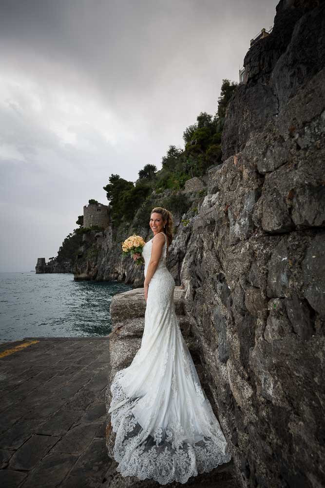 Bride portrait with wedding dress posing on the stairs. Amalfi coast.