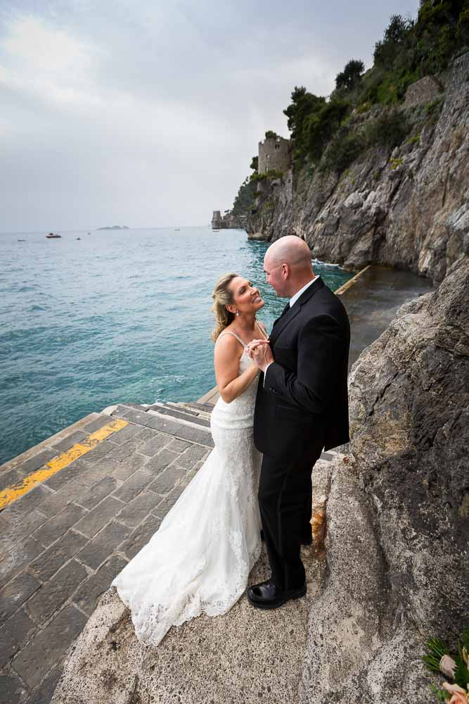 Bride and groom together by the Mediterranean sea