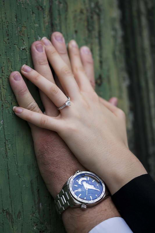 Holding hands together during an e-session