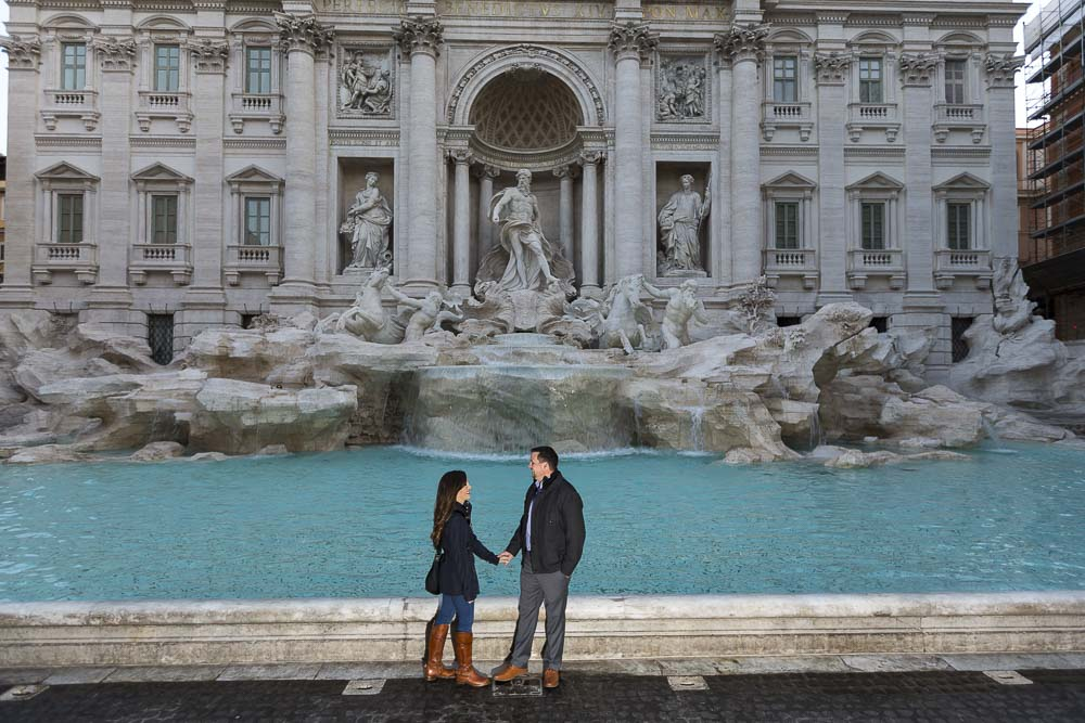 Couple standing at the Trevi fountain