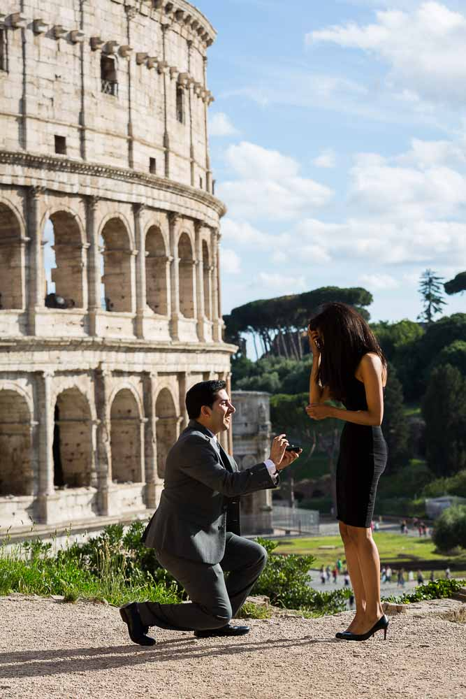 Man kneeling down for a wedding proposal at the Coliseum