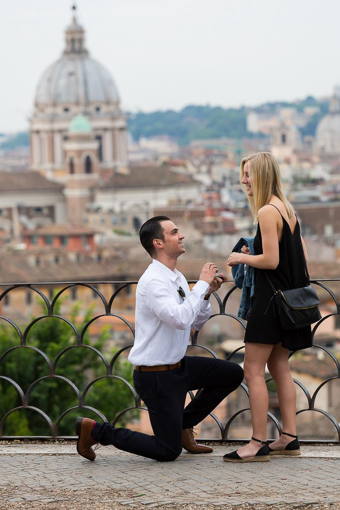 Man asking wedding marriage at Parco del Pincio in Rome Italy. Surprise Engagement Photography in Rome