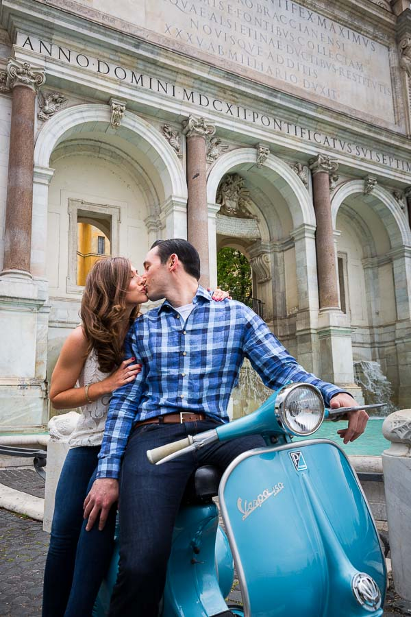 In love. Kissing by the Fontanone water fountain on a vespa.