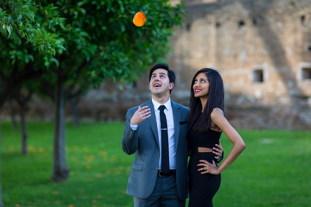 Throwing an orange in the air