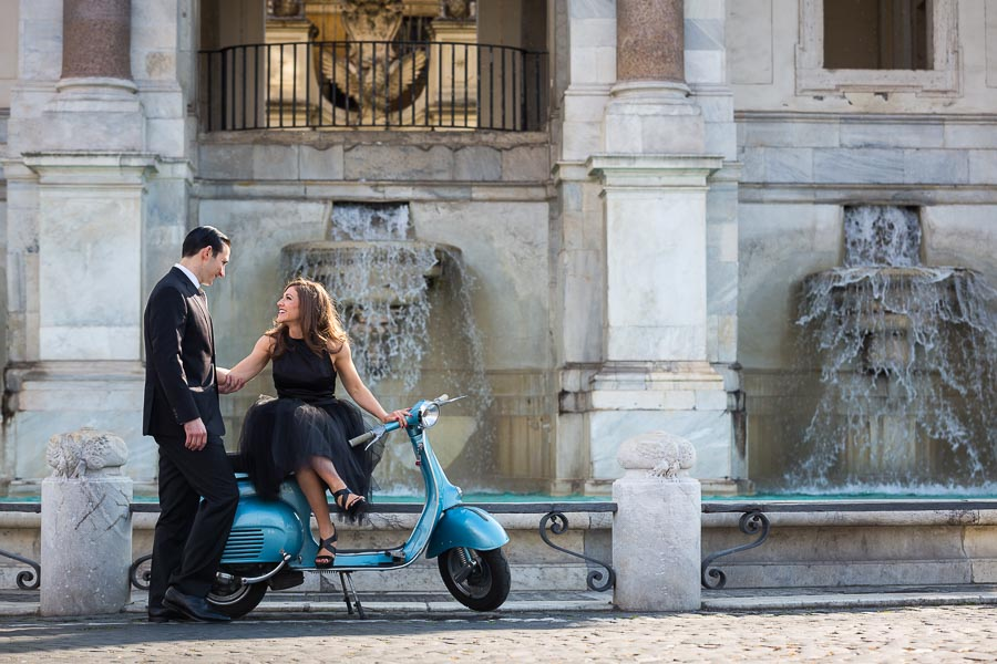 Coupe engagement photography sitting on a vespa during a photo shoot in Rome Italy