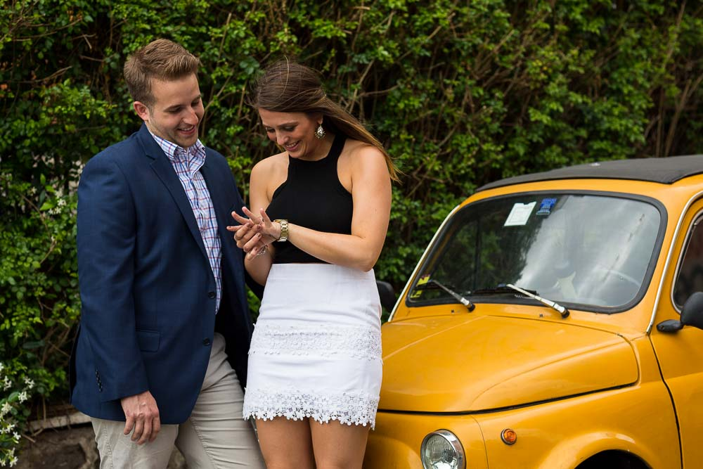 Yellow Fiat cinquecento looking at the engagement ring closer