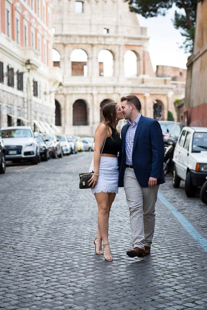 Walking in love in Rome. Romantic image of a couple walking while kissing