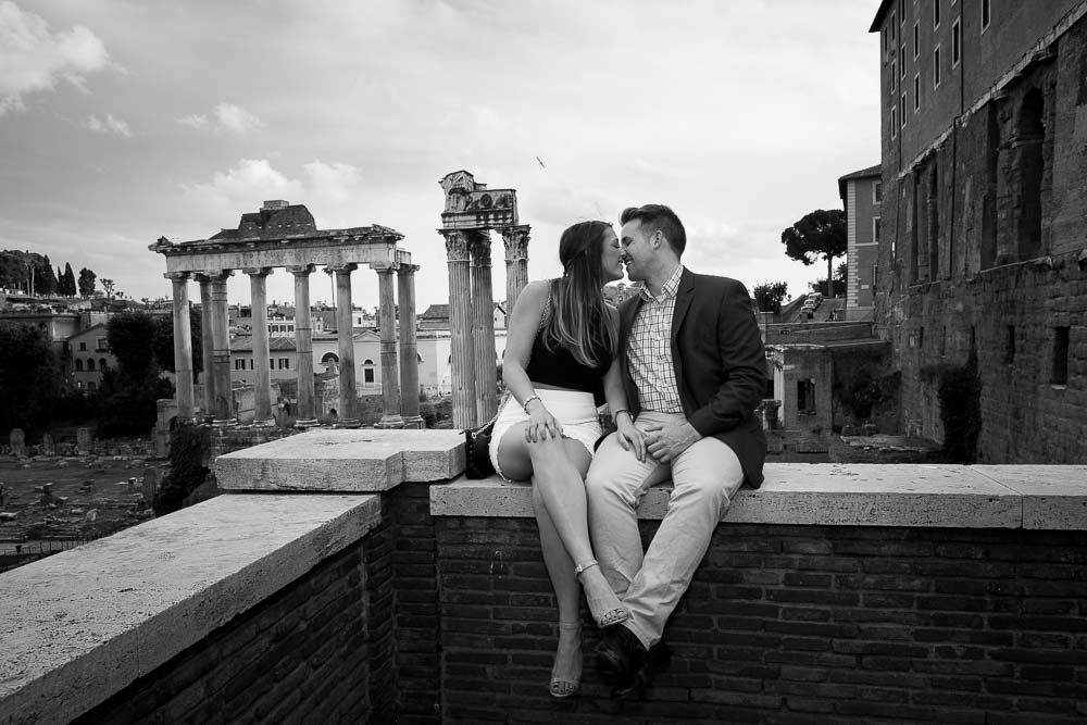 Kissing at the Roman Colosseum in Rome Italy. B&w view