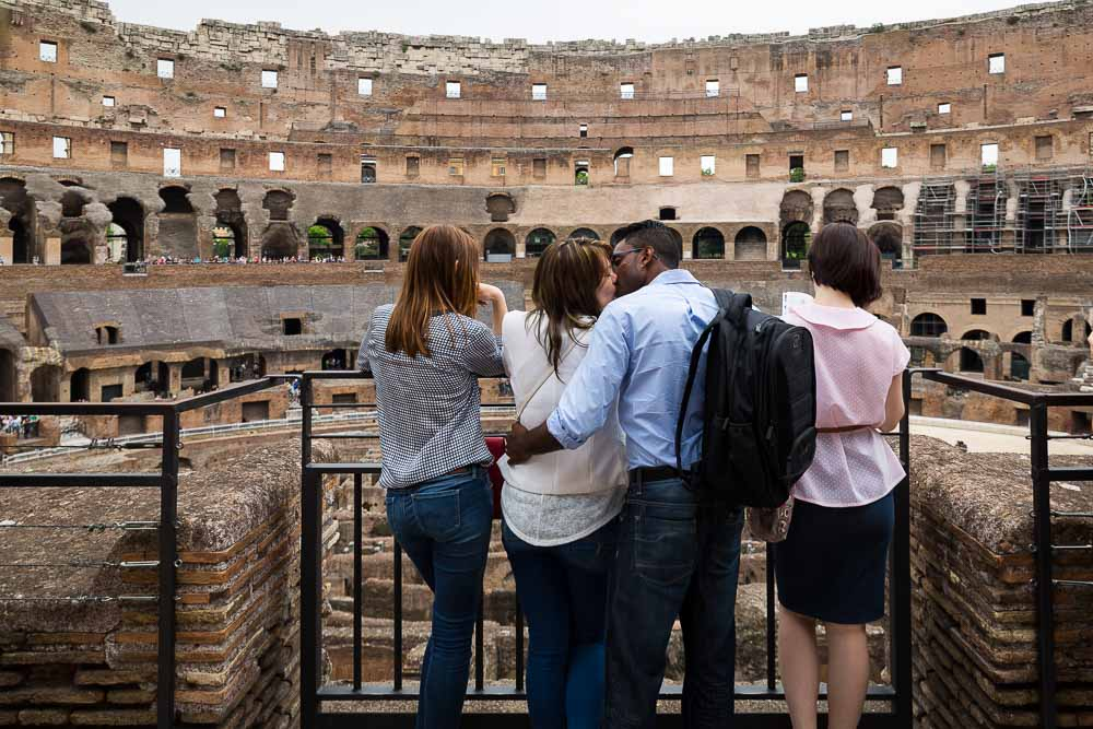 Couple in love inside the roman coliseum