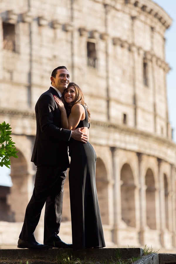 Portrait picture of a couple in formal attire at the Roman Colosseum