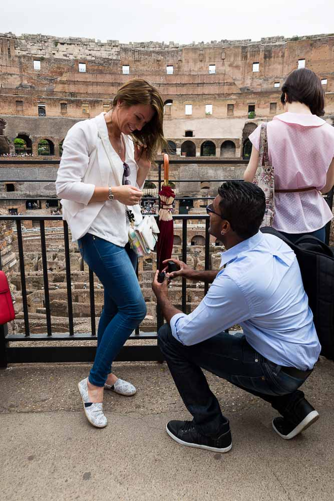 Knee down question will you marry me inside the roman Colosseum. Rome, Italy. Proposing at the Roman Colosseum