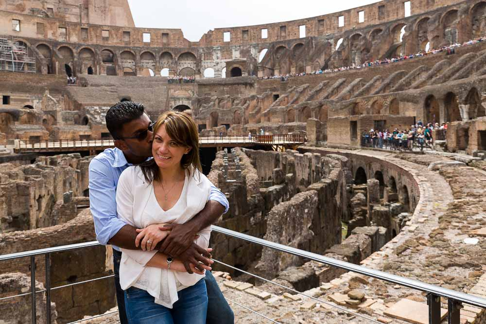 Just engaged picture portrait of a couple inside the Colosseum in Rome Italy