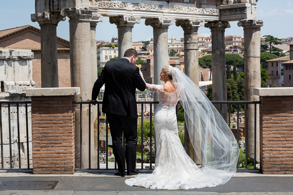 Newlyweds looking at the roman forum