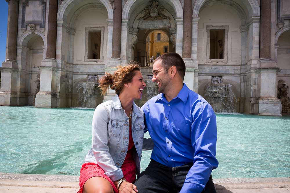 Engaged couple portrait at the Gianicolo water fountain