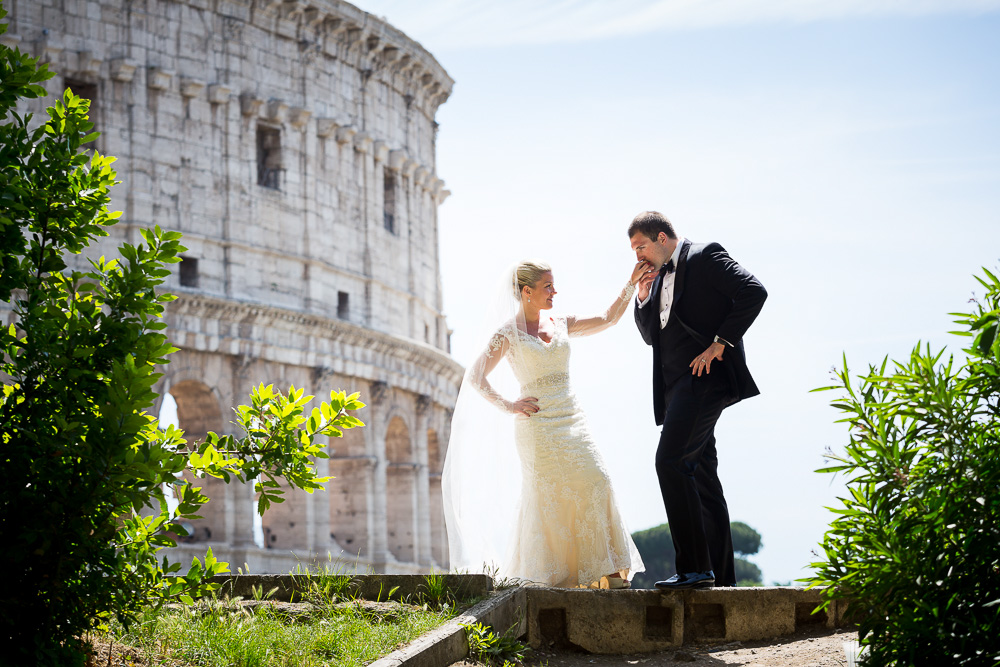 Gallantry gesture at the Roman Colosseum during a wedding photography session