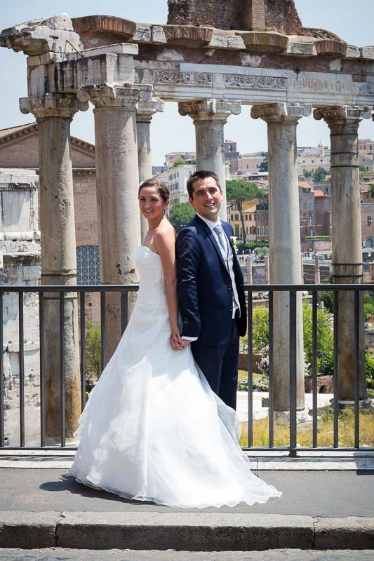 Newlywed portrait at the Roman Forum with ancient ruins in the background