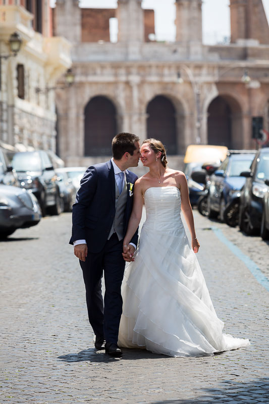 Bride and groom walking together in the streets and alleyways of Rome