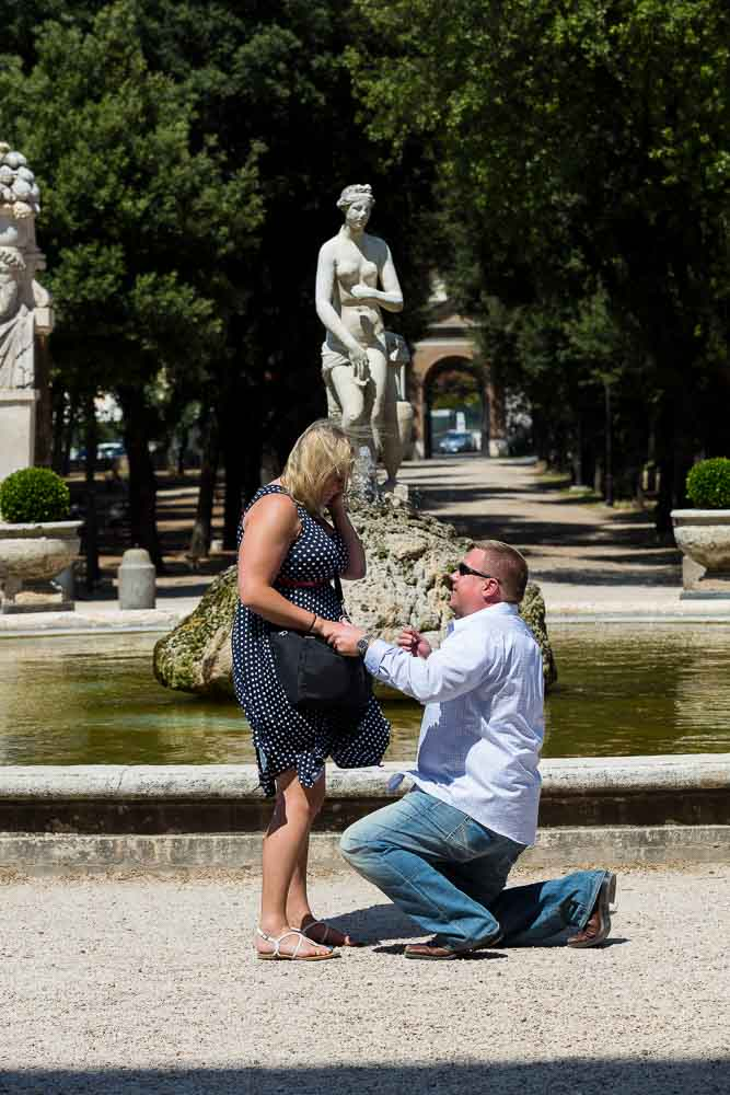 Man knee down Rome Marriage Proposal at the gardens of Villa Borghese