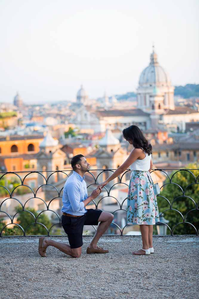 Man knee down Surprise Rome Proposal photography at Parco del Pincio in Rome Italy