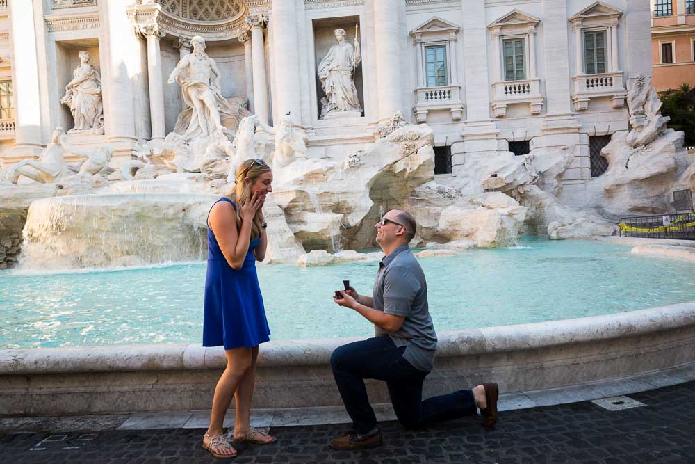 Wedding marriage proposal taking place at the Trevi fountain in Rome Italy