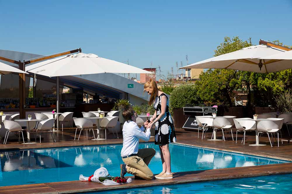 Romantic poolside surprise wedding proposal in a Hotel roof garden