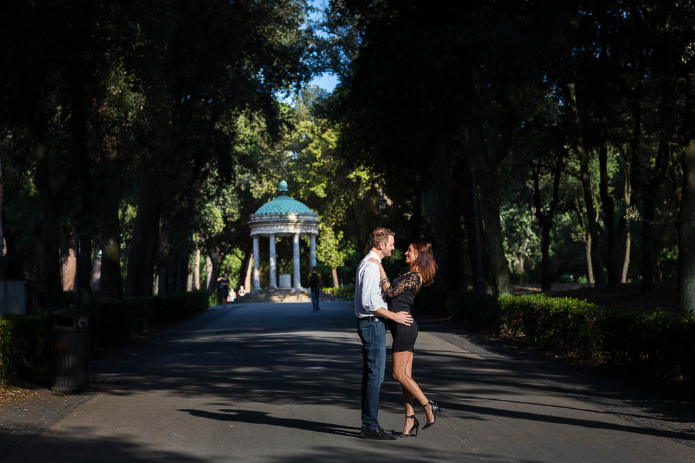 Couple posing in front of temple of Diana in Rome Italy