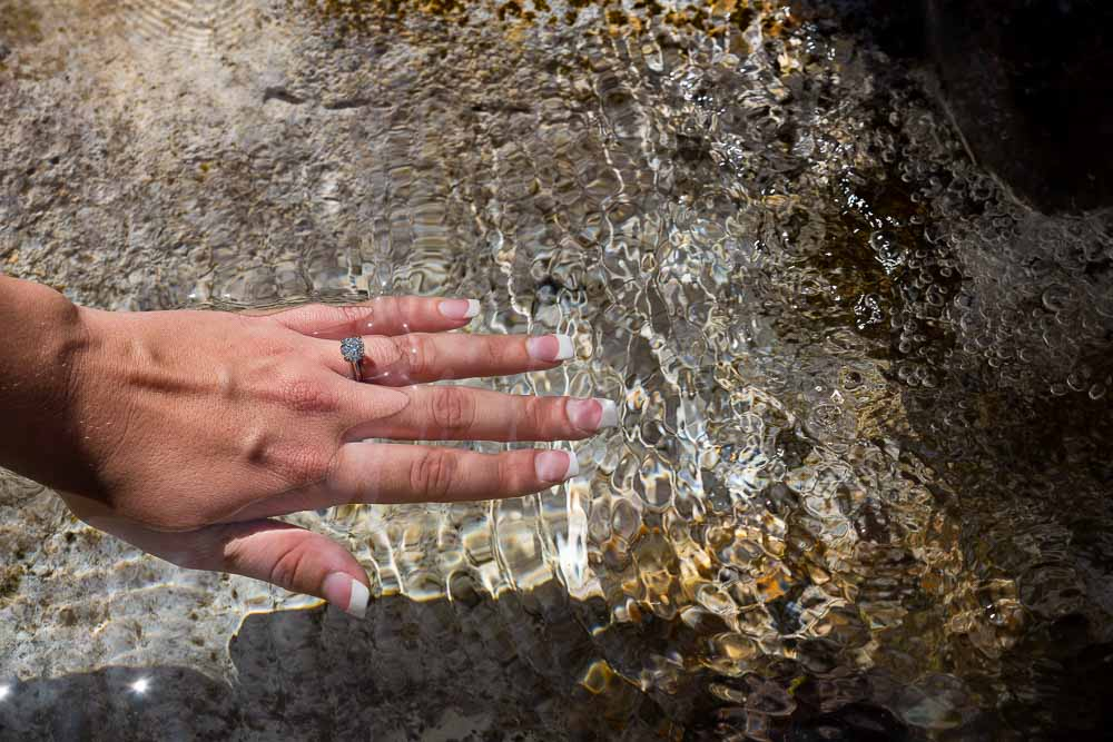 Hand in the water engagement ring photography