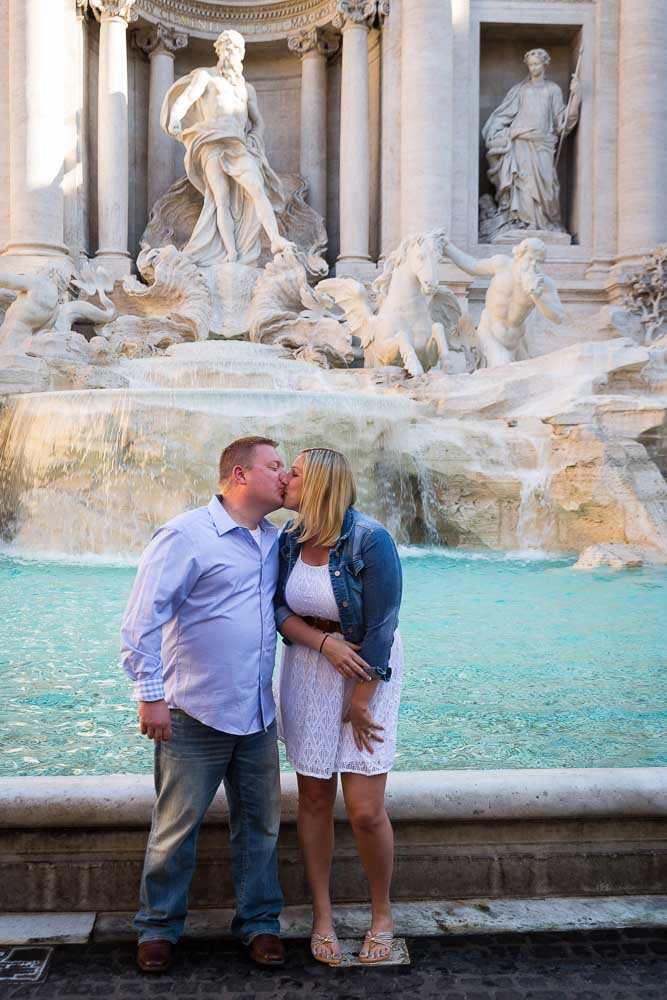 Engaged in Rome. Kissing at the Trevi fountain