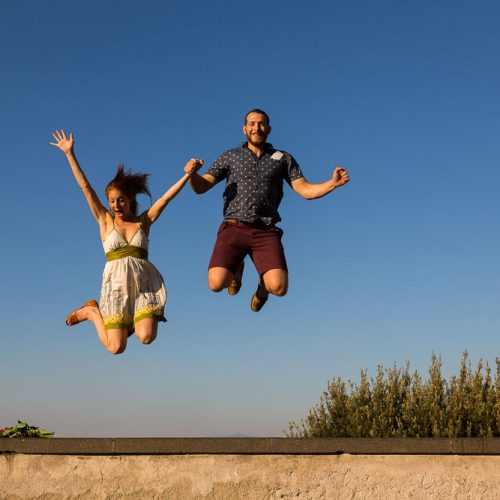 Fun engagement pictures taken while jumping in the air