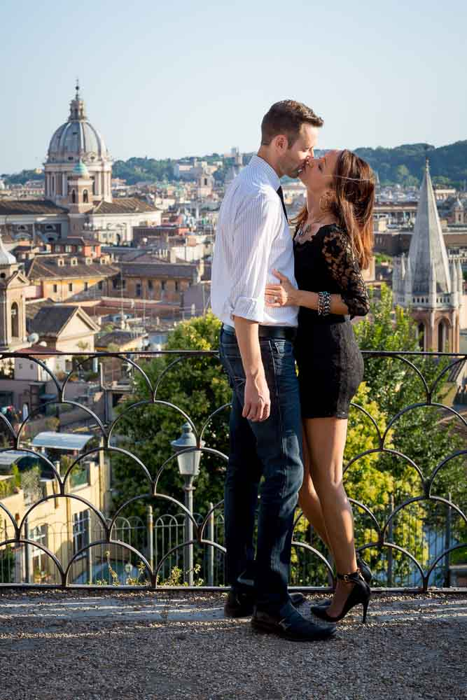 Kissing overlooking the city from above