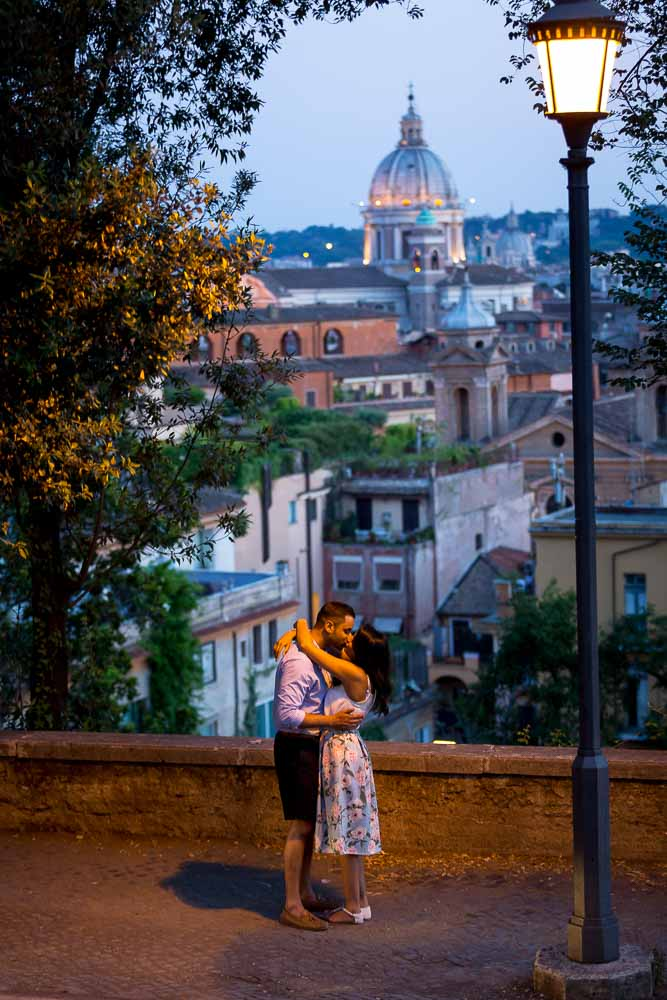Engagement photo session under street lamp post at dusk in Rome Italy
